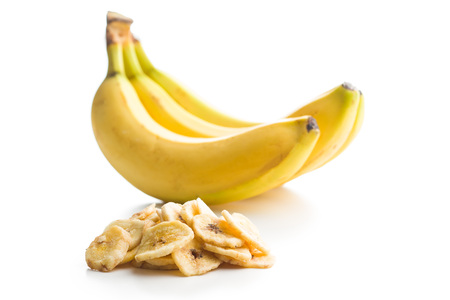 Dried banana chips isolated on white background. Standard-Bild