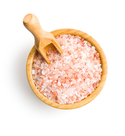 Pink himalayan salt in bowl isolated on white background. Imagens
