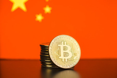 Golden bitcoins and chinese flag. Digital cryptocurrency. Фото со стока