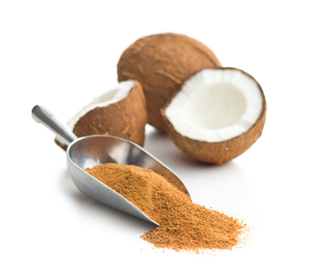 Sweet coconut sugar in scoop isolated on white background.
