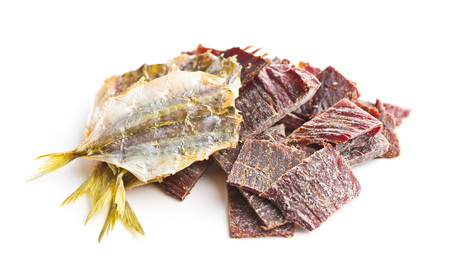 Dried salted fish and jerky isolated on white background.