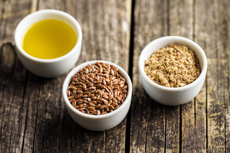 The healthy brown linseeds, minced linseed and oil. Stock Photo