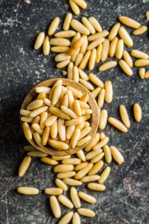 Healthy pine nuts in bowl. Top view. Stock Photo
