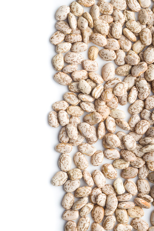 Dried borlotti beans isolated on white background.