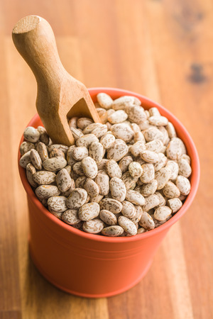 Dried borlotti beans in cup. Archivio Fotografico