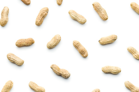 The unpeeled peanuts isolated on white background. Reklamní fotografie