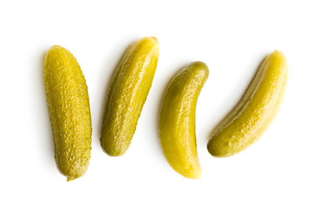 Preserved cucumbers isolated on white background. Tasty pickles. Stock Photo