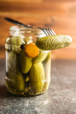 Pickles in bowl. Tasty preserved cucumbers in jar.