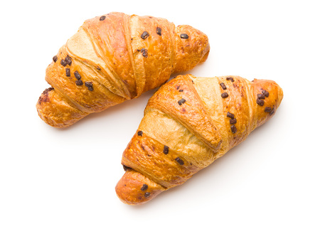 Two croissants with chocolate crumbs isolated on white background.