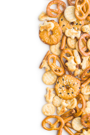 Mixed salty snack crackers and pretzels isolated on white background. 免版税图像