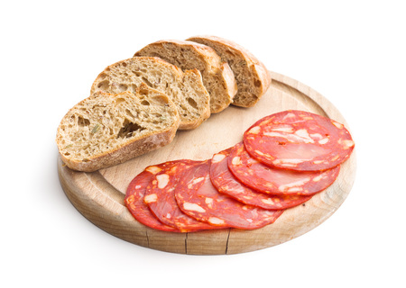 Sliced chorizo salami sausage and bread isolated on white background.