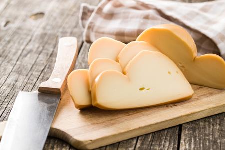 Scamorza, italian smoked cheese on cutting board.