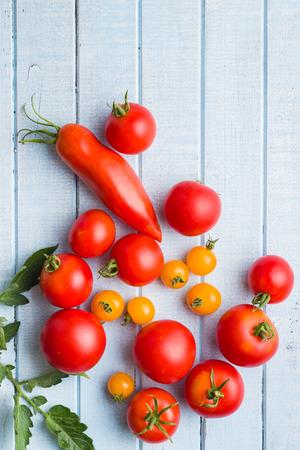 Tasty various tomatoes on kitchen table.
