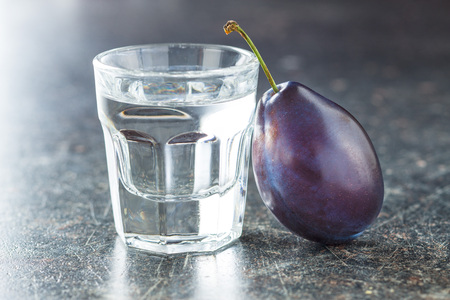 Plum brandy and plums. Tasty slivovitz. Stok Fotoğraf