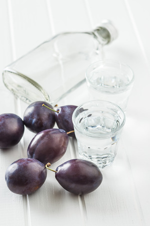 Plum brandy and plums. Tasty slivovitz. Banco de Imagens