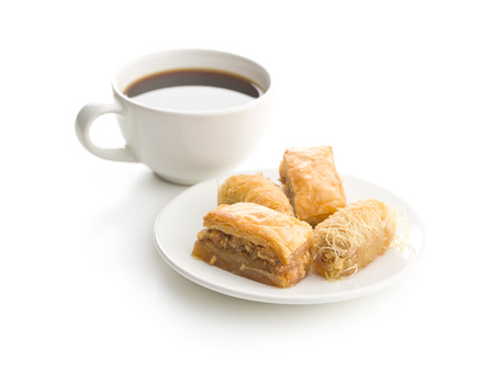 Sweet dessert baklava and kantaifi with coffee cup isolated on white background. 版權商用圖片
