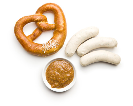 The bavarian weisswurst, pretzel and mustard isolated on white backround.