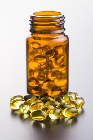 Omega 3 gel capsules in glass bottle. Фото со стока