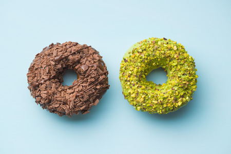 Sweet glazed donuts on blue background. Banco de Imagens