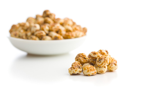 Tiger nuts. Tasty chufa nuts. Healthy superfood isolated on white background.