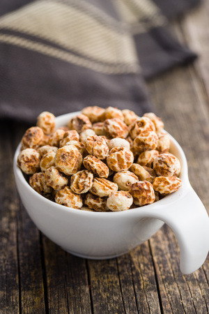 Tiger nuts. Tasty chufa nuts. Healthy superfood in bowl.