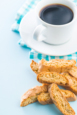 Sweet cantuccini biscuits. Italian biscotti and coffee cup on blue background. Archivio Fotografico