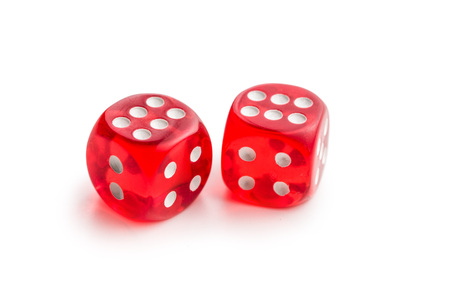 Red glass playing dices isolated on white background. Foto de archivo