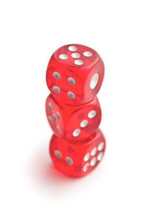 Red glass playing dices isolated on white background.