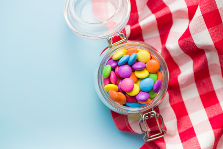 Colorful chocolate candy pills in jar. Stock Photo