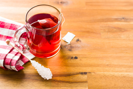 Fruit red tea on wooden table.