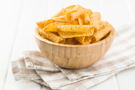 Rolled tortilla chips in bowl.