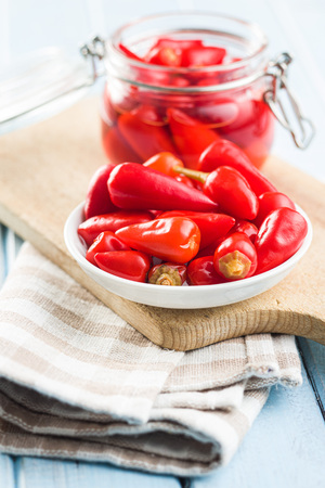 Pickled chili peppers in bowl. Banco de Imagens