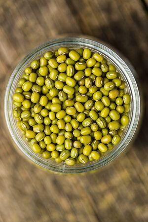 Green mung beans in jar. Top view.