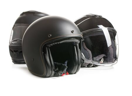 Three black motorcyle helmets isolated on white backgorund.