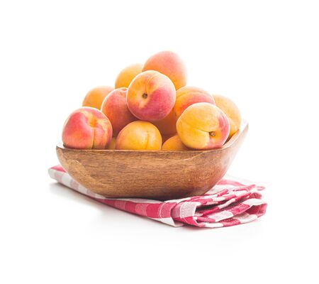 Sweet apricot fruits in bowl isolated on white background.