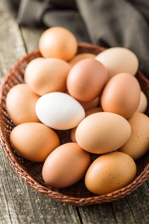Raw chicken eggs in basket.