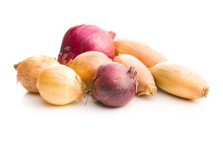 The golden shallot onion. Fresh bulbs isolated on white background.