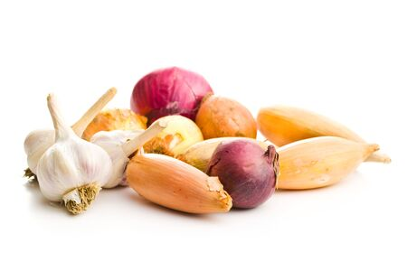 The golden shallot onion and garlic. Fresh bulbs isolated on white background.