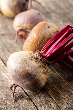 Tasty raw beetroot. Healthy vegetable on old wooden table.