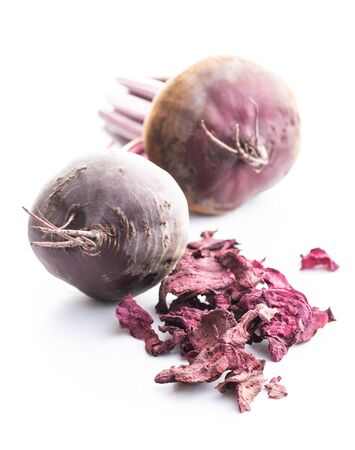 Tasty raw beetroot and dried beetroot. Healthy vegetable isolated on white background.