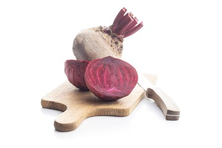 Tasty raw beetroot. Sliced beetroot on cutting board isolated on white background.
