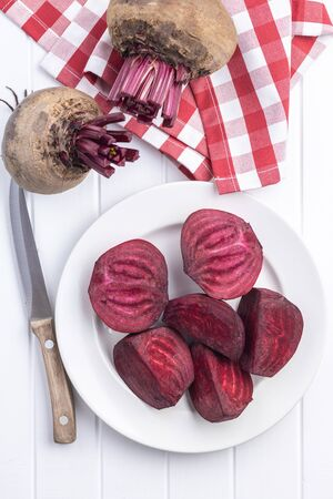 Tasty raw beetroot. Sliced beetroot on plate. Top view.