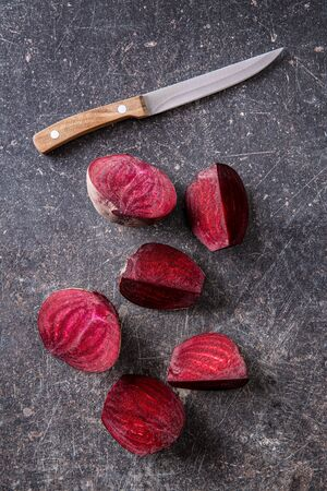 Tasty raw beetroot. Sliced beetroot and knife. Top view. 写真素材