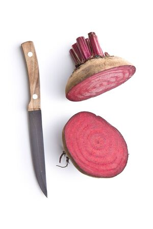 Tasty raw beetroot. Sliced beetroot and knife isolated on white background.