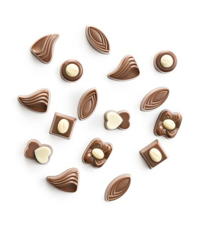 Various chocolate pralines isolated on white background.
