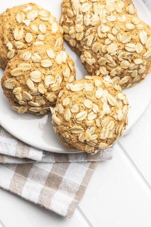 Cereal oatmeal cookies on white table.