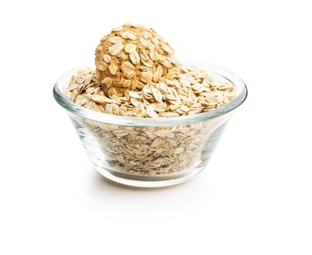 Cereal oatmeal cookies and oatmeal in bowl isolated on white background.