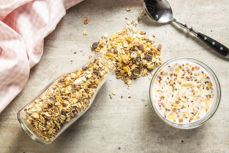 Healthy cereal breakfast. Mixed muesli and bowl of milk. Flat view. Archivio Fotografico - 139514543