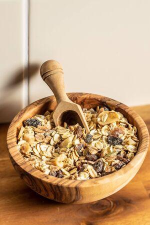 Healthy cereal breakfast. Mixed muesli in wooden bowl. Archivio Fotografico - 139514510