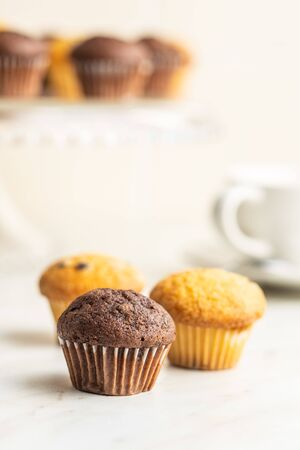 Sweet muffins. Chocolate cupcakes on kitchen table. Archivio Fotografico - 139619426